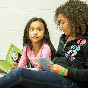 Girls reading at LaPlaza